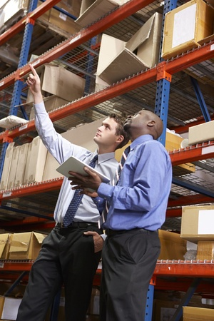 Two Businessmen With Digital Tablet In Warehouse Stock Photo - 19530855