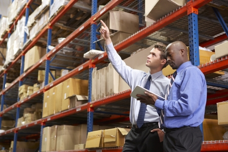 Two Businessmen With Digital Tablet In Warehouse Stock Photo - 19530919