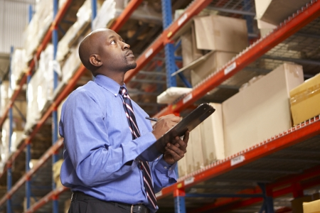 Businessman With Digital Tablet In Warehouse