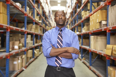 Portrait Of Businessman In Warehouse photo