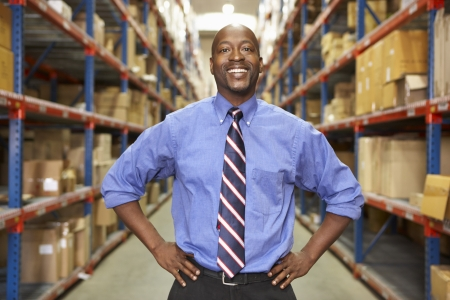 warehouse worker: Portrait Of Businessman In Warehouse