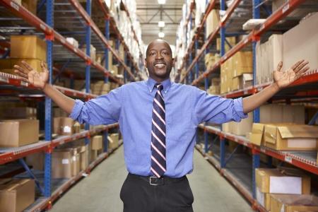 manual worker: Portrait Of Businessman In Warehouse