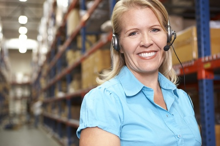 warehouse worker: Businesswoman Using Headset In Distribution Warehouse