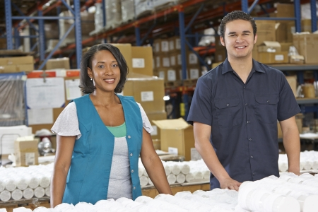 warehouse worker: Factory Workers Checking Goods On Production Line