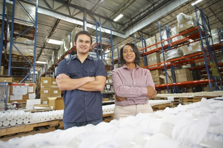 Portrait Of Factory Worker And Manager On Production Line photo