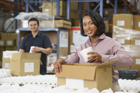 packaging industry: Manager Checking Goods On Production Line
