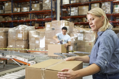 packing tape: Workers In Distribution Warehouse