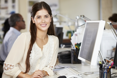 industry workers: Woman Working At Desk In Busy Creative Office