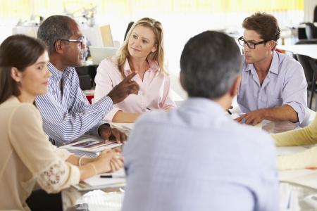 business teamwork: Team Meeting In Creative Office