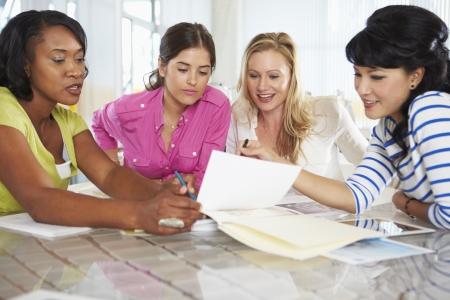 women talking: Group Of Women Meeting In Creative Office