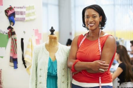 african american woman: Fashion Designer In Studio Stock Photo