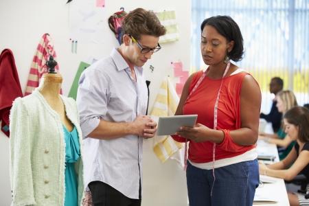 textile designer: Man And Woman Meeting In Fashion Design Studio