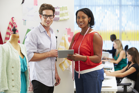 Man And Woman Meeting In Fashion Design Studio Stock Photo - 23128763