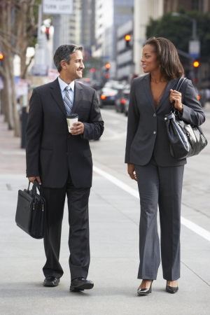 business briefcase: Businessman And Businesswoman In Street With Takeaway Coffee