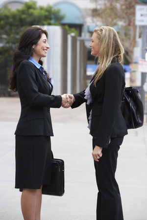 Two Businesswomen Shaking Hands Outside Office Stock Photo - 23128860