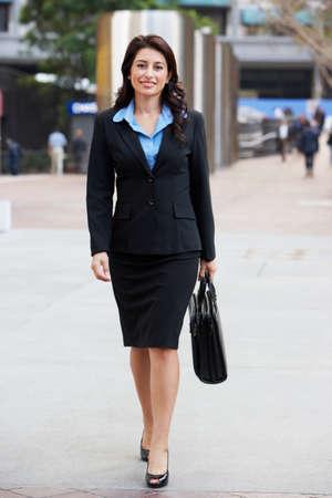 Portrait Of Businesswoman Walking Along Street photo