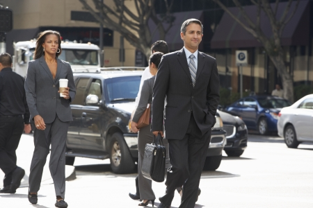 Group Of Businesspeople Crossing Street photo