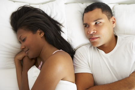 african american couple: Couple In Bed With Relationship Difficulties