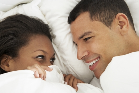 romantic sexy: Couple Relaxing In Bed Wearing Pajamas