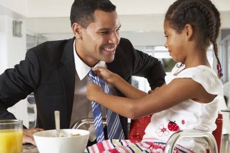 he: Daughter Straightens Fathers Tie Before He Leaves For Work