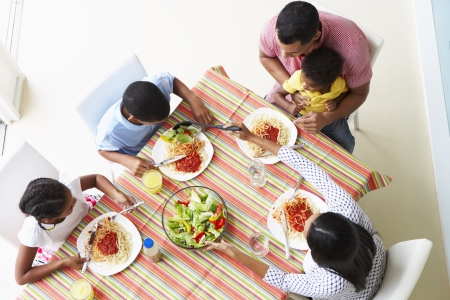 overhead view: Overhead View Of Family Eating Meal Together Stock Photo