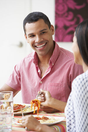 Couple Eating Meal Together At Home photo