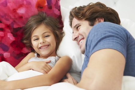 two year old: Father And Daughter Lying In Bed Together