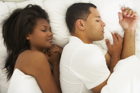 Couple Sleeping In Bed Together photo