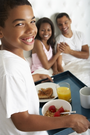 Son Bringing Parents Breakfast In Bed photo