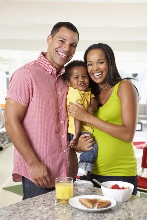 black family: Family Having Breakfast In Kitchen Together Stock Photo