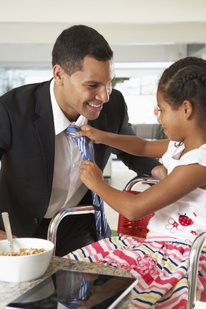 Daughter Straightens Father's Tie Before He Leaves For Work photo