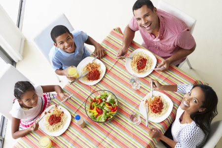 old people eating: Overhead View Of Family Eating Meal Together Stock Photo