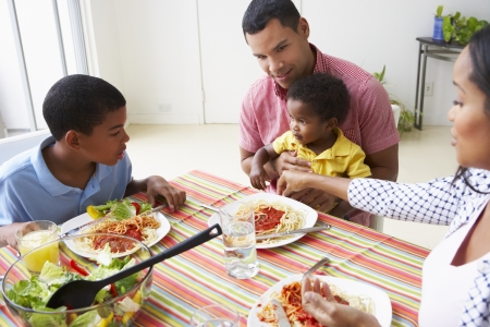 happy black family: Family Eating Meal Together At Home