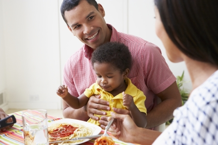 Family Eating Meal Together At Home photo