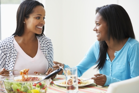 Two Women Eating Meal Together At Home photo