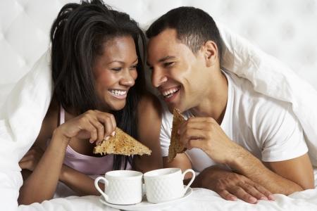 bed and breakfast: Couple Enjoying Breakfast In Bed