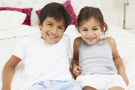 5 year old girl: Children Lying On Bed In Pajamas Together