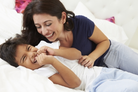 tickling: Mother And Son Lying In Bed Together