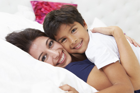 Mother And Son Lying In Bed Together photo