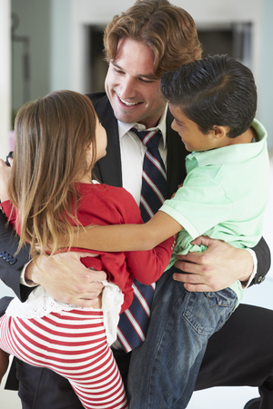 5 year old girl: Children Greeting Father On Return From Work Stock Photo