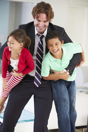 Children Greeting Father On Return From Work photo