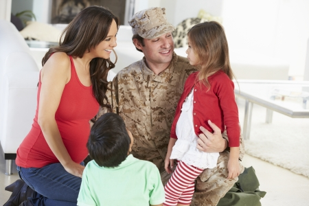 military man: Family Greeting Military Father Home On Leave Stock Photo