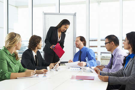 Businesswoman Conducting Meeting In Boardroom photo