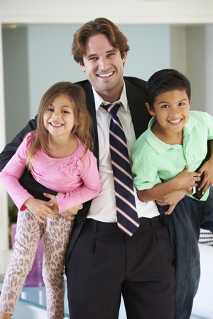 arriving: Children Greeting Father On Return From Work Stock Photo