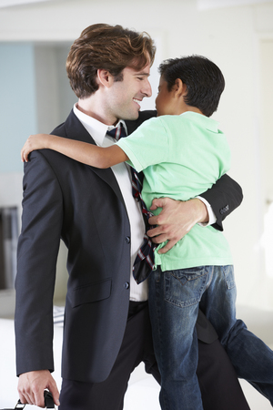 Son Greets Father On Return From Work photo