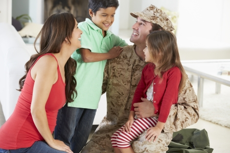 mom and dad: Family Greeting Military Father Home On Leave Stock Photo