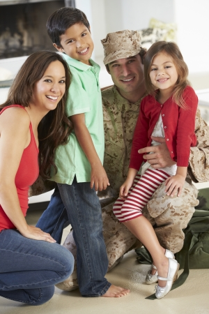 leave: Family Greeting Military Father Home On Leave Stock Photo