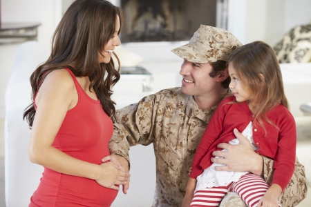 Family Greeting Military Father Home On Leave Stock Photo - 24447213