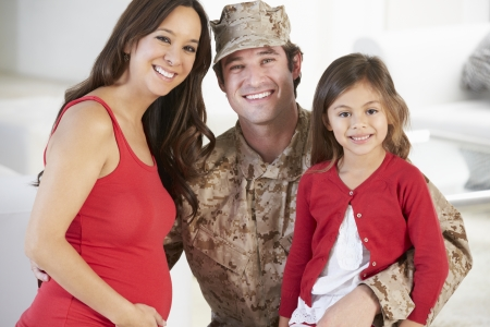 army uniform: Family Greeting Military Father Home On Leave Stock Photo