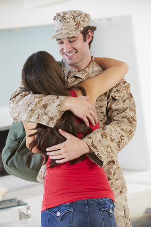 welcome home: Wife Greeting Military Husband Home On Leave